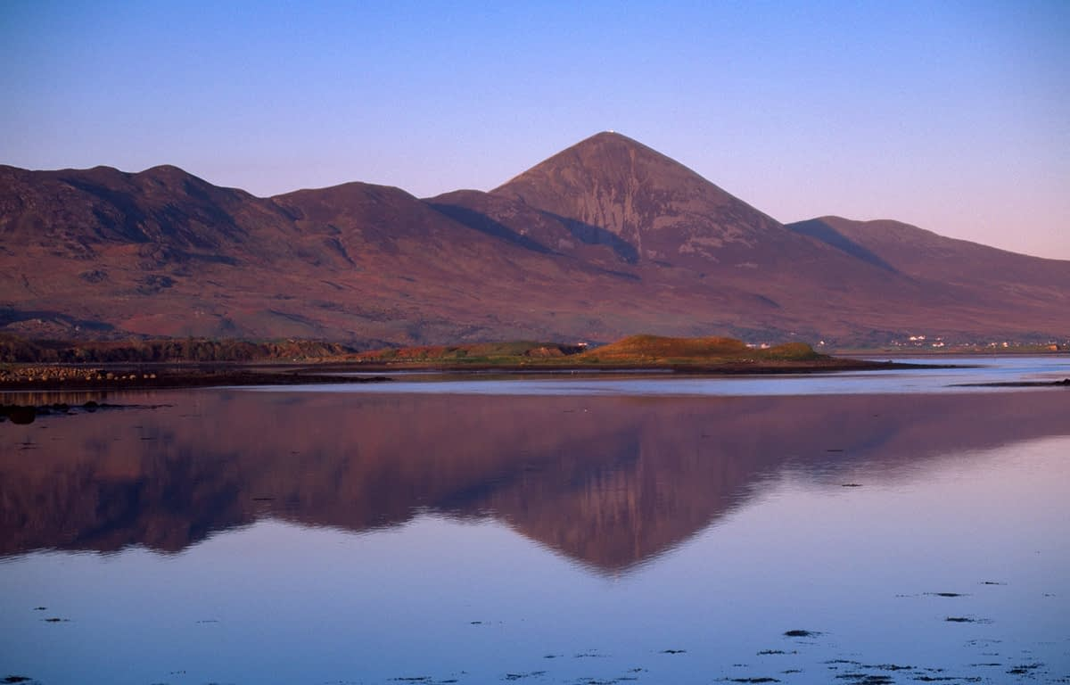 Dawn reflection of Croagh Patrick in Clew Bay, County Mayo, Ireland.